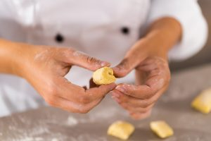 Detail of hands making gnocchi