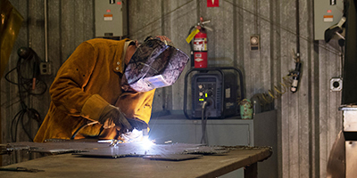 Student welding at SCC.