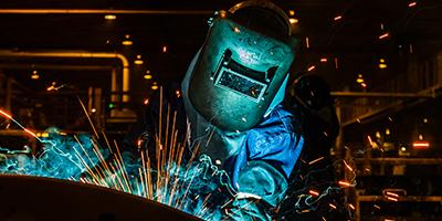 Welder, welding in a car factory