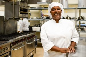 Student Chelsea Covington poses for a photo in the SCC culinary kitchens.