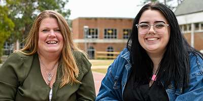 Maggie Duskin, left, and her daughter Lexie, right, pose for a photo outside on the SCC campus.