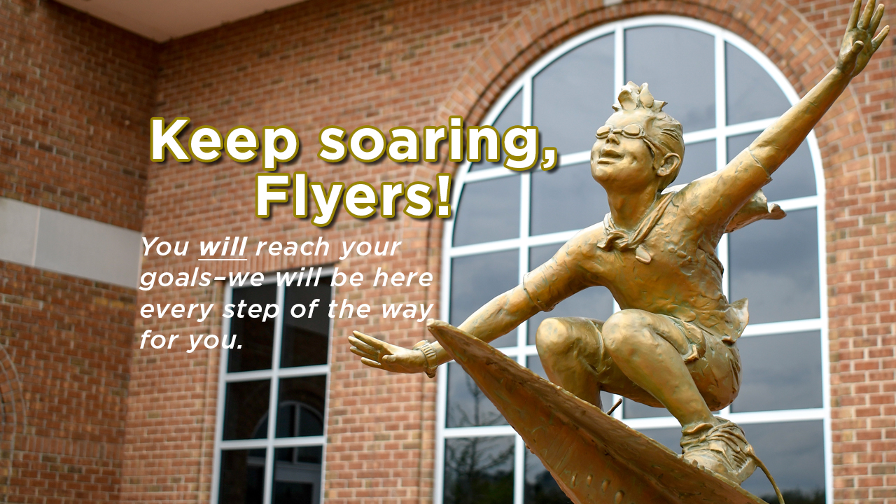 Photo of the outside of Dempsey Student Center with Flyers statue in foreground. Text that reads,