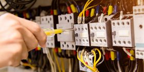 Close up of an electrician's hand working.
