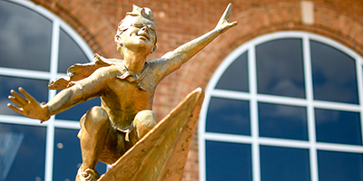 Close up of the Flyers Statue in front of Dempsey Student Center.