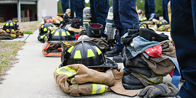 Close up of fire equipment at students' feet.