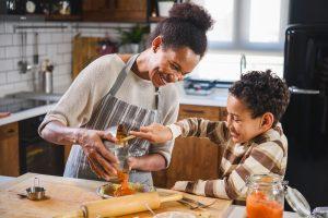 Adult and child making pumpkin pie.