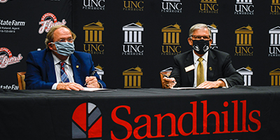 Dr. Dempsey and UNCP Chancellor Robin Gary Cummings sign a BraveStep agreement at SCC.