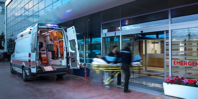 Paramedics taking a patient into the emergency room of a hospital.