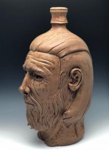 Sculpture of a head, created by a student in Ceramic Design class.