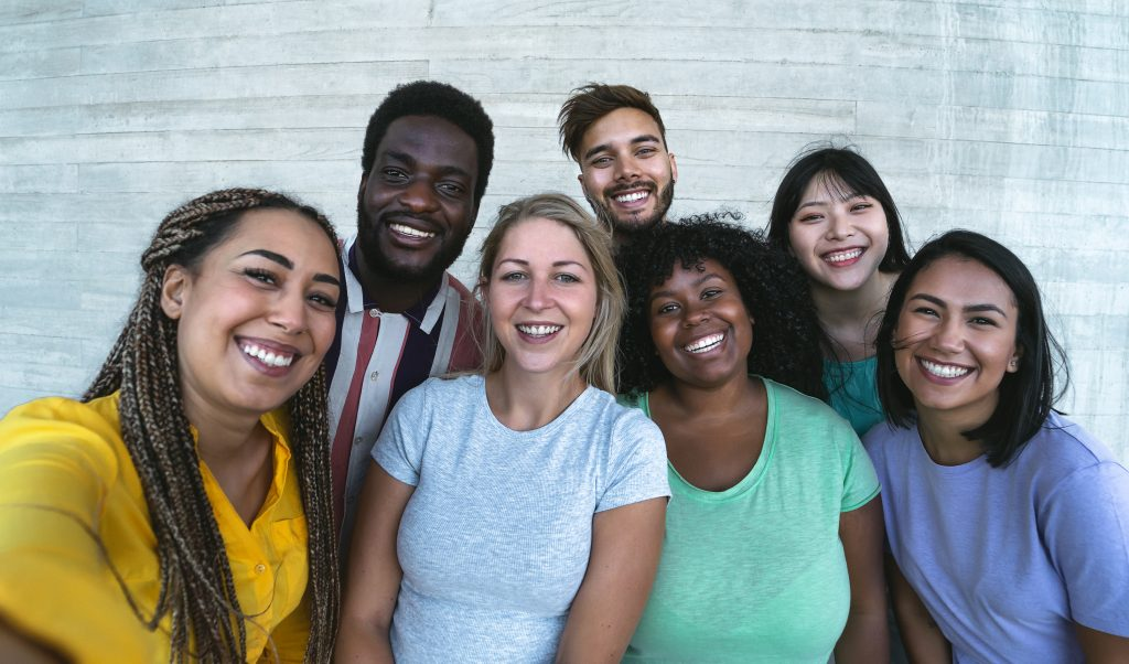 Group multiracial friends having fun outdoor